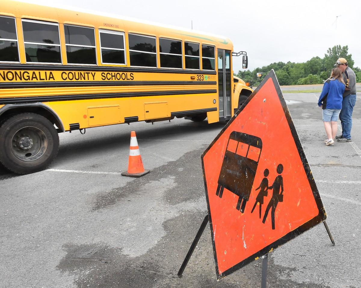 Monongalia County school bus behind caution sign