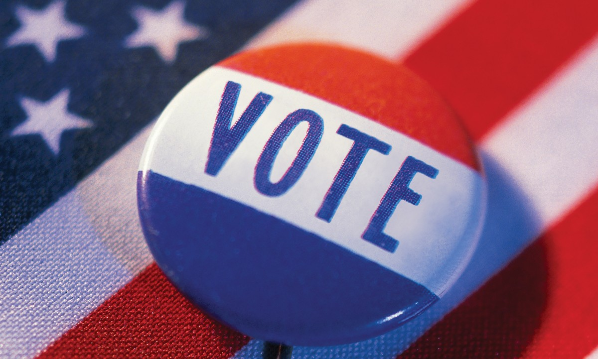 stock image of voter button on flag