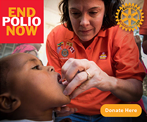 "Image of a Rotary Club member giving a small girl the Polio Vaccination. An End Polio now logo is shown and a ""Donate Now"" button at the bottom to leave donations for the campaign. Join the International Rotary Club to end the spread of Polio!"
