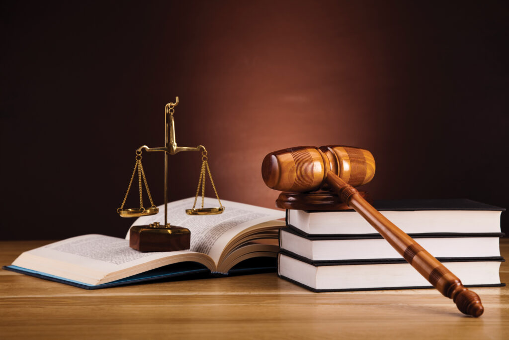 stock image of legal books, gavel, and scales