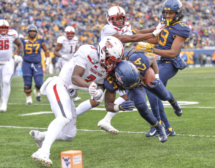 West Virginia running back Tony Mathis (24) struggled to keep his feet against Texas Tech due to nerves, but Neal Brown says he will continue to get carries this season (William Wotring/The Dominion Post).