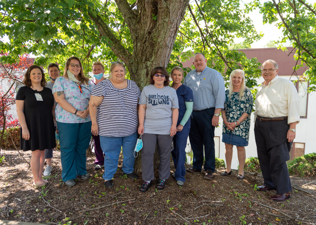 sundale staff under a tree