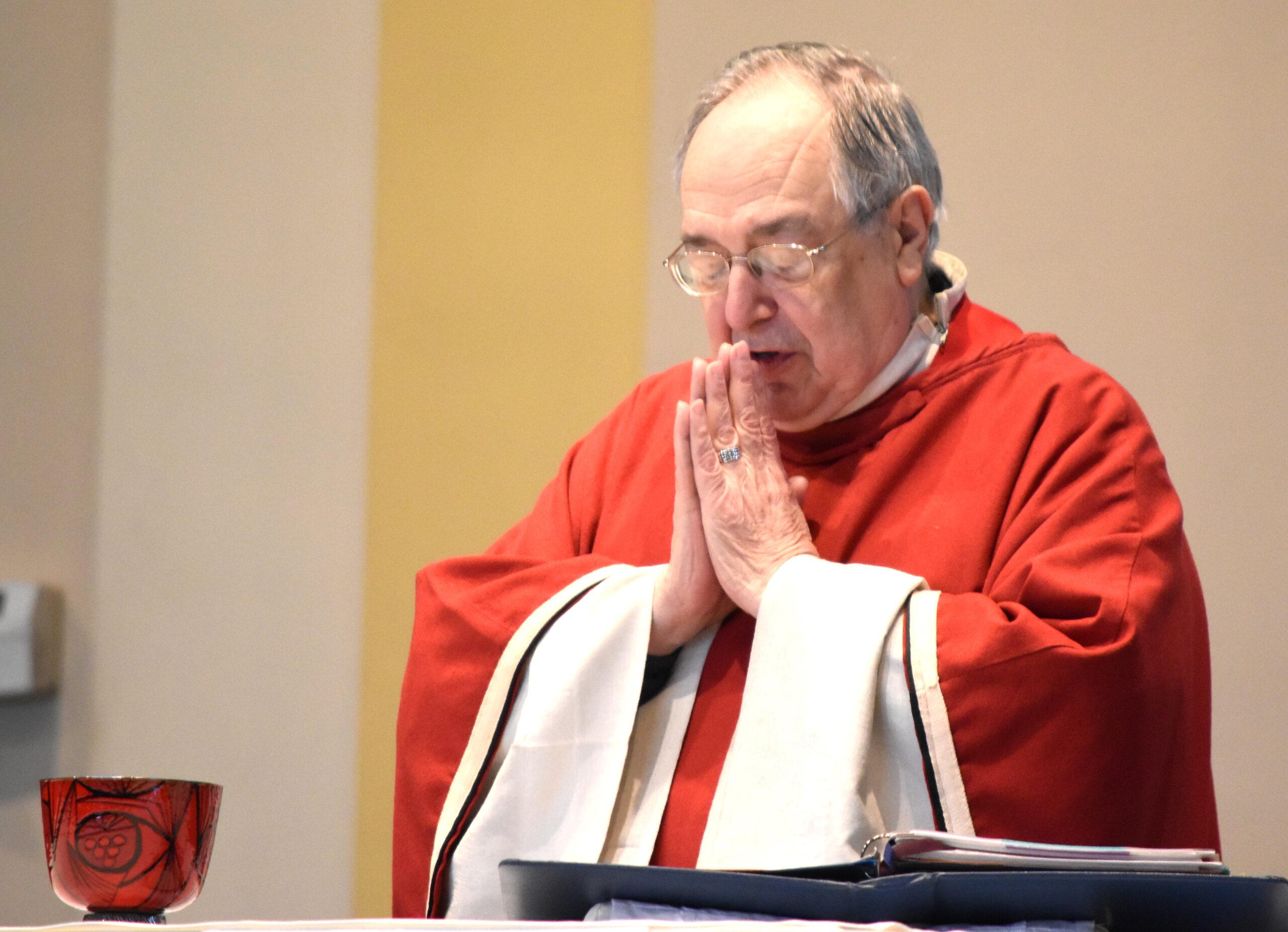 John DiBacco prays