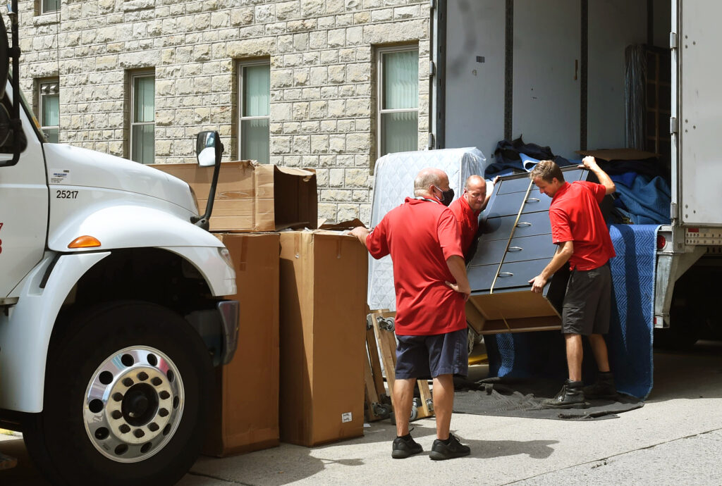 movers unload furniture at Arnold hall