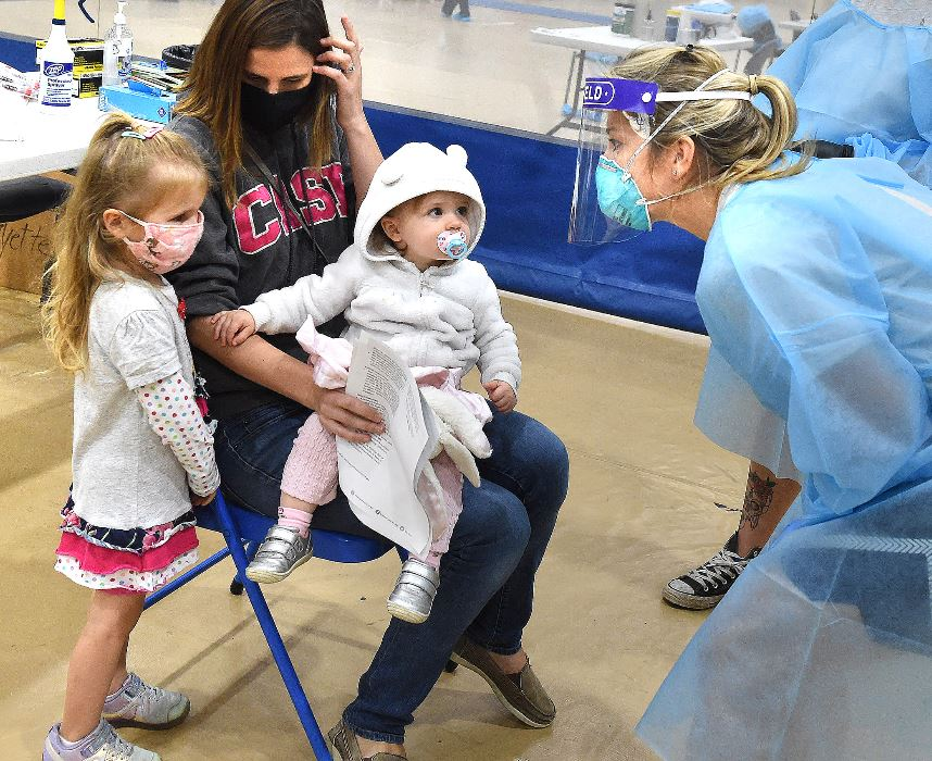 family waits to be tested at rec center