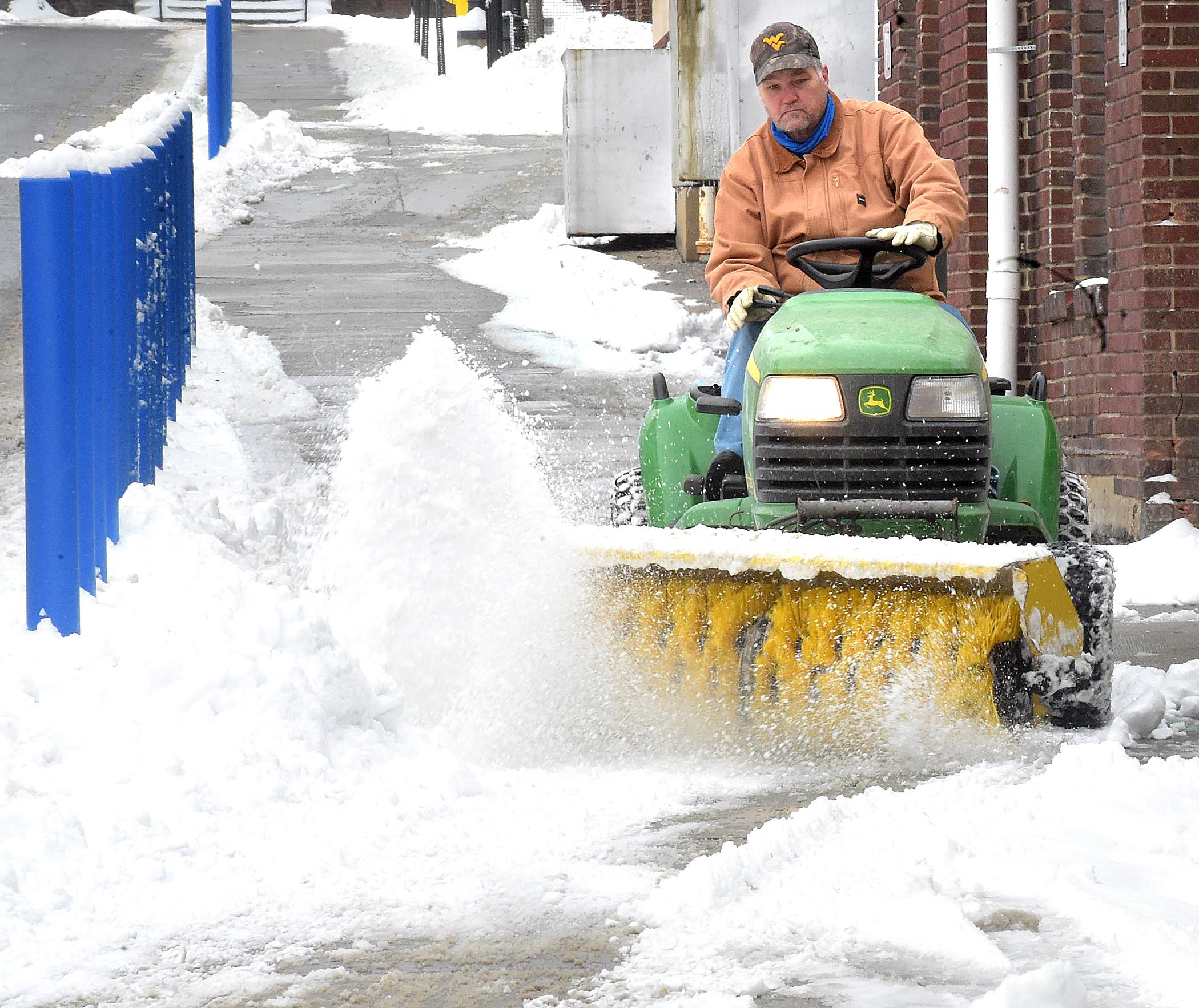 sweeping snow by Morgantown High School