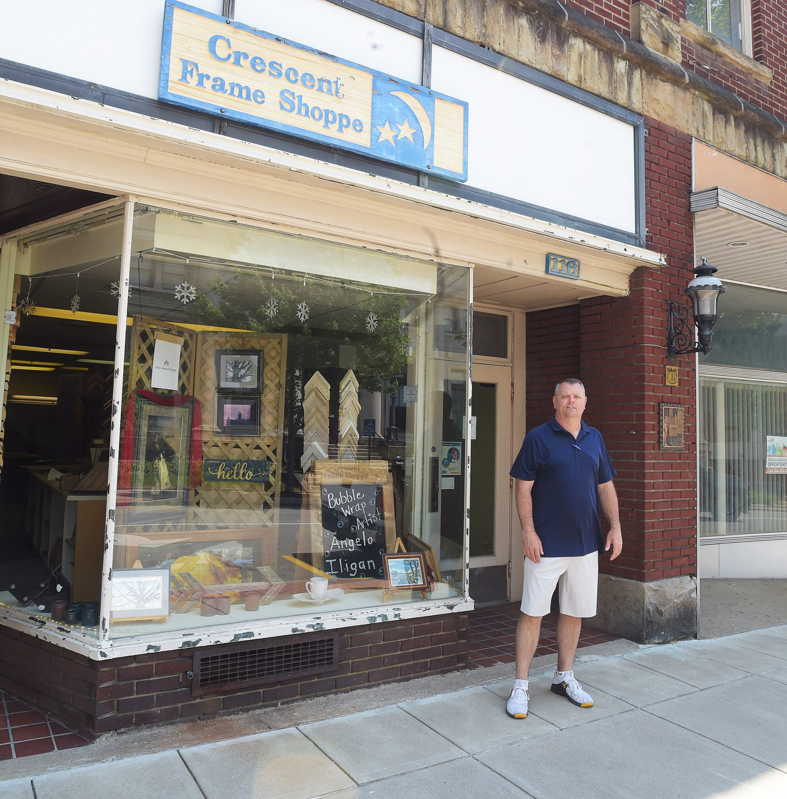 Mike Quick, owner, in front of Crescent Frame Shoppe